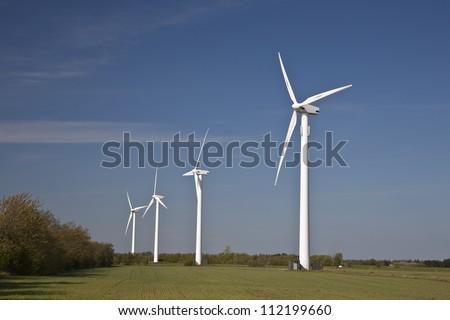Wind turbines in field - stock photo