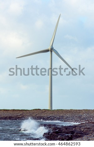 wind turbines in Ireland stone beach