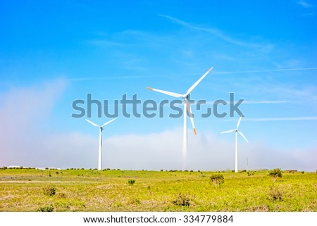 wind turbines in natural landscape - green meadow - stock photo