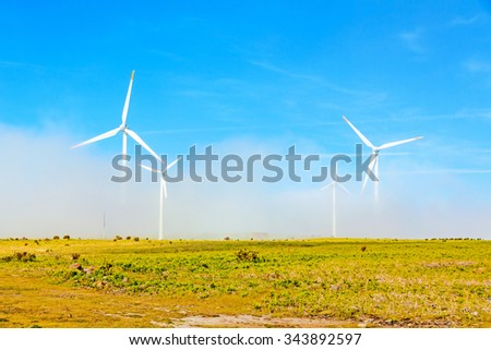 wind turbines in natural landscape - green meadow