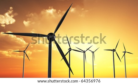Wind turbines in orange sunset/sundown (back lit).