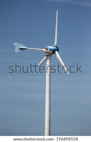 Wind turbines in running on blue sky background.