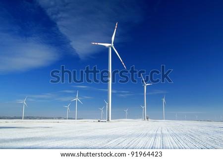 Wind turbines in snow - stock photo