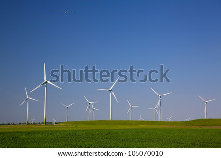 Wind turbines in the farmland with a clear blue sky in the Netherlands