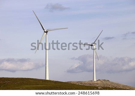 wind turbines in the top of the mountain - stock photo