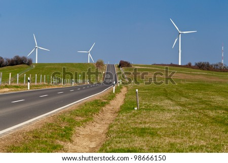 Wind turbines installations in the countryside for green energy - stock photo