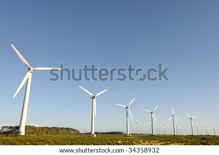 Wind turbines isolated against the sky - stock photo