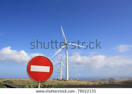 Wind turbines near a road sign for forbidden traffic (Lanzarote Canary Islands) - stock photo