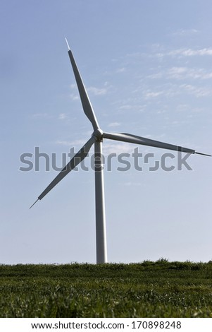 wind turbines on a hill in static position