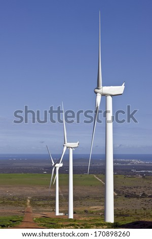 wind turbines on a hill in static position - stock photo