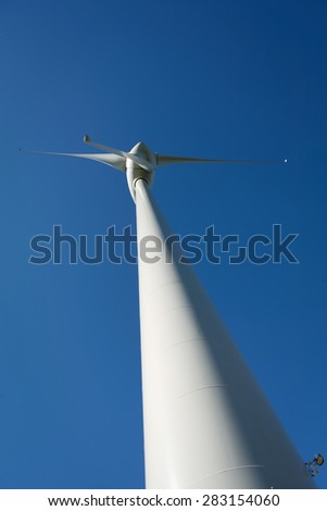 Wind Turbines on a modern windmill farm for alternative energy production. Electricity is powered ecological and considered better for the environment over oil and other fossil fuels.   - stock photo