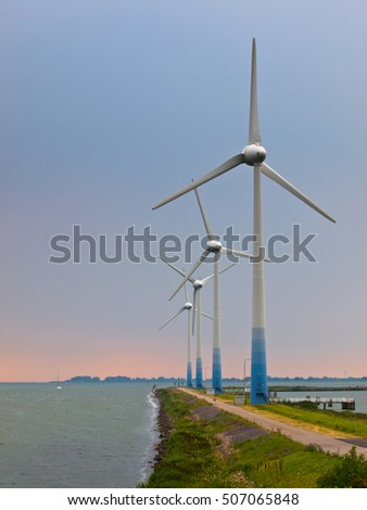 Wind Turbines on a pier at IJsselmeer in the Netherlands