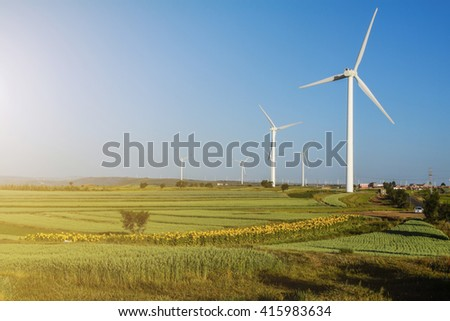 Wind Turbines on a Wind Farm in Sunlight, China - stock photo