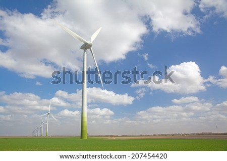 Wind turbines on argricultural land - stock photo