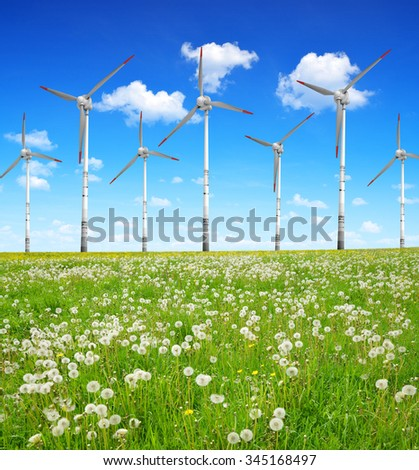 Wind turbines on meadow. Clean energy.