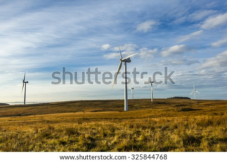Wind Turbines on moorland at Hartside, Northumberland, England. UK. In early morning light.