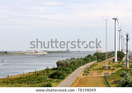 Wind turbines on the entrance of rotterdam harbor - stock photo