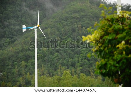 Wind turbines on the forest background.