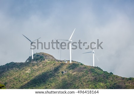 wind turbines on the mountain top, background of the new energy