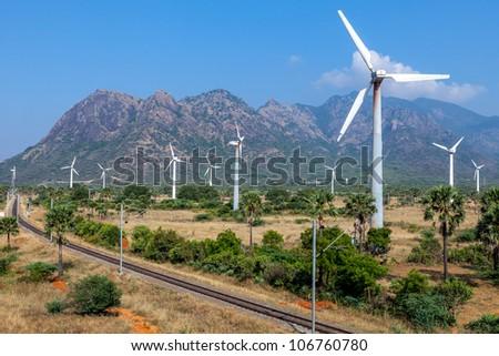 wind turbines on the road - stock photo