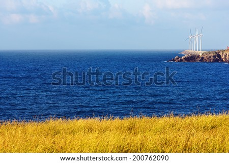 wind turbines on the sea on sunny day - stock photo