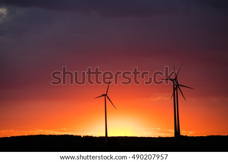 wind turbines on the sunset sky background