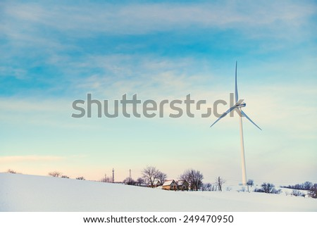 Wind turbines on winter field