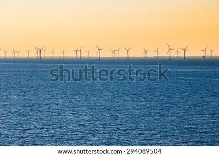 WInd turbines out at sea in baltic sea  - stock photo