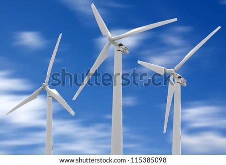 Wind turbines over blue sky - stock photo