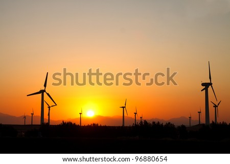 Wind turbines over sunset in Egypt - stock photo