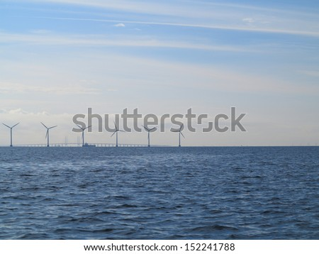 wind turbines power generator farm for renewable energy production along coast baltic sea near Denmark. Alternative green clean energy, ecology.