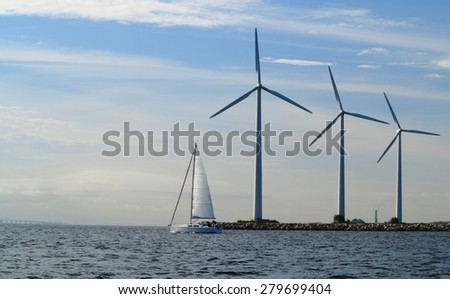 wind turbines power generator farm for renewable energy production along coast baltic sea near Denmark. Alternative green clean energy, ecology. - stock photo
