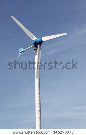Wind turbines produce electricity for energy and the environment.