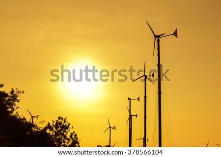 Wind turbines silhouette at sunset  at koh larn pattaya thailand - stock photo