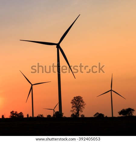 Wind turbines silhouette at sunset inThailand