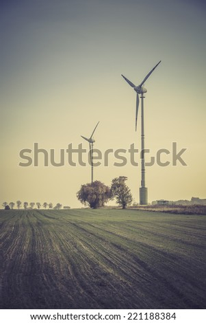 Wind turbines silhouette in the meadow