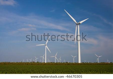Wind turbines standing in field. Wind power. - stock photo