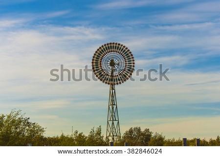 Wind turbines Thailand flag pattern on Blue sky sunset background - stock photo
