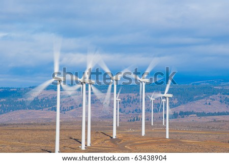 Wind turbines with fast moving blades blurred with long exposure
