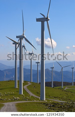 wind turbines with sheep on grass - stock photo
