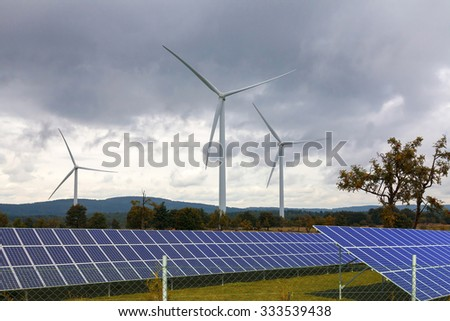Wind turbines with solar panels - stock photo