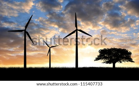 Wind turbines with tree in the sunset