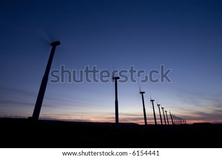 Wind turbines with turning blades at dusk in eastern Washington