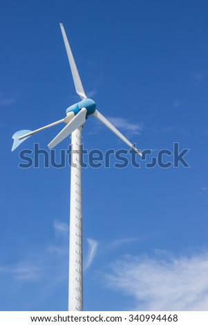 Wind wheel and blue sky - stock photo