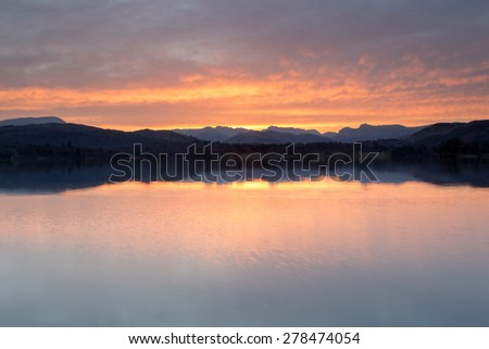 Windermere sunset, looking towards the Langdale Pikes - stock photo
