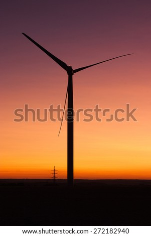 Windfarm at sunset and sky with dust from Kasatochi volcano - stock photo