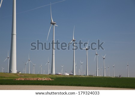 Windfarm with a clear blue sky producing alternative energy