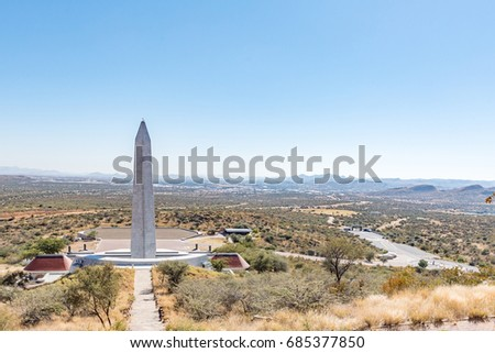 WINDHOEK, NAMIBIA - JUNE 16, 2017:  Heroes Acre, an official war memorial of the Republic of Namibia with Windhoek in the back