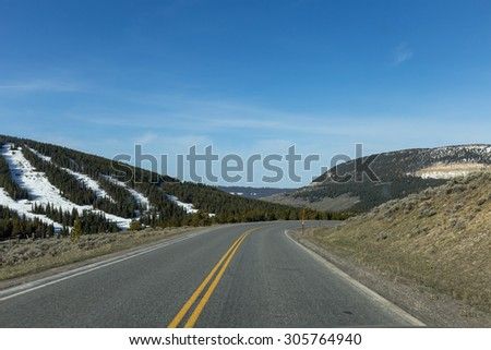 Winding around U.S. 14 in the Bighorn National Forest - stock photo