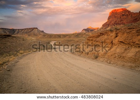 Winding desert dirt road in the San Rafael Swell, Utah, USA.